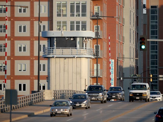 Traffic moves out of downtown Green Bay heading west across the Walnut Street bridge over the Fox River Wednesday, Nov. 8, 2017 in Green Bay, WIs. Car owners face the possibility of a wheel tax from the city.