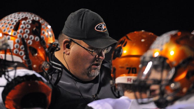 Lucas head football coach Scott Spitler talks to his players during a Division VII playoff game against Tiffin Calvert. Spitler was named Coach of the Year by the News Journal.