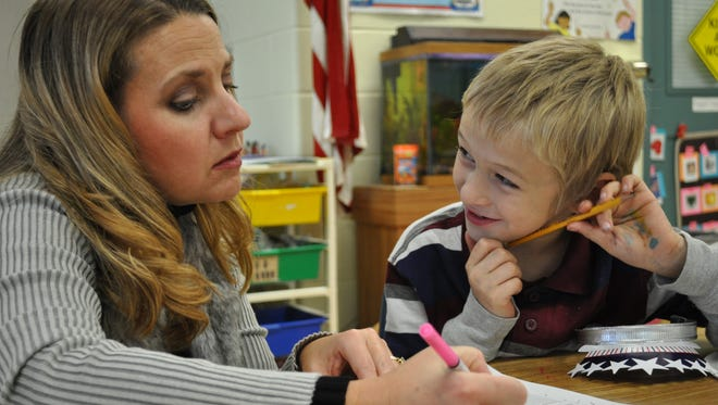 Jefferson Elementary School second-grade teacher Wanda Kern works with a student. Kern is featured in the UW Oshkosh Humans of Oshkosh Teachers Storytelling Project.
