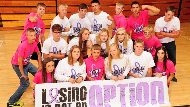 """Students from five area schools -- Iowa Valley, Williamsburg, English Valleys, HLV and Belle Plaine -- gather to help raise awareness of cancer in all forms, as part of the kickoff to Marengo Memorial Hospital's new """"Hope For All"""" program."""
