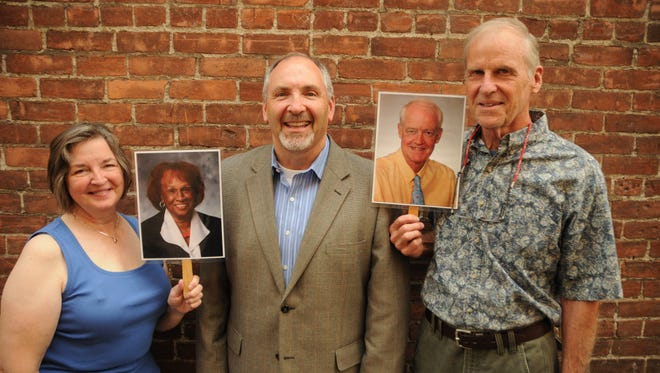 Sharon Pierson, Allan Pollock and Ed Millis pose with photos of Oregon Senators Jackie Winters and Peter Courtney at the Statesman Journal's Holding Court at the Court Street Dairy Lunch in downtown Salem on Tuesday, Sept. 5, 2017.
