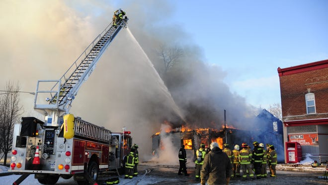 Firefighters pour water on an apartment house fire in Berville. Berlin Township is among the communities asking voters to approve fire protection taxes.