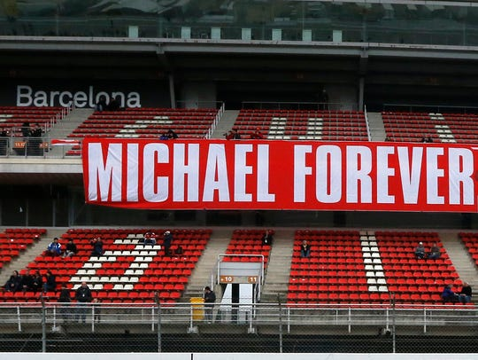 A tribute-banner to Michael Schumacher hangs in the