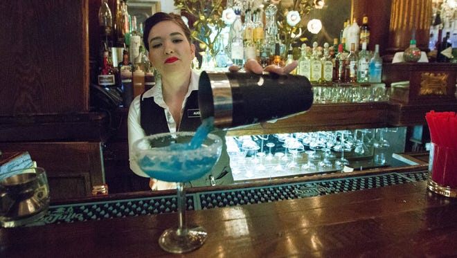 Audrey tenor, a bartender at the Double Eagle, in Mesilla, pours a Turquoise Margarita into a glass,, Tuesday April 24, 2018.