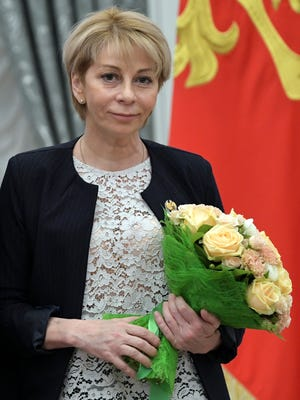 In this Thursday, Dec. 8, 2016 file photo, Yelizaveta Glinka holds a bunch of flowers at an award presentation ceremony for charity and human rights achievements in the Kremlin in Moscow. A Russian plane headed to an air base in Syria with 92 people aboard, including Glinka, a Russian doctor widely known for her charity efforts, crashed into the Black Sea on Sunday, Dec. 25, 2016, minutes after taking off from the city of Sochi.