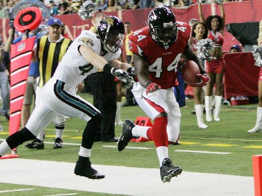 Atlanta Falcons fullback Fred McCrary (44) scores a first-quarter touchdown ahead of Jacksonville Jaguars safety Nick Sorensen (41) during an NFL preseason football game at the Georgia Dome in Atlanta Thursday, Aug. 31, 2006. (AP Photo/Ric Feld)