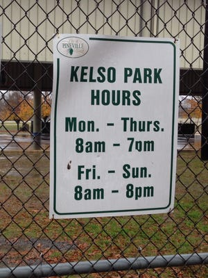 A sign gives the hours for the sheltered outdoor Kelso Park basketball court in Pineville.