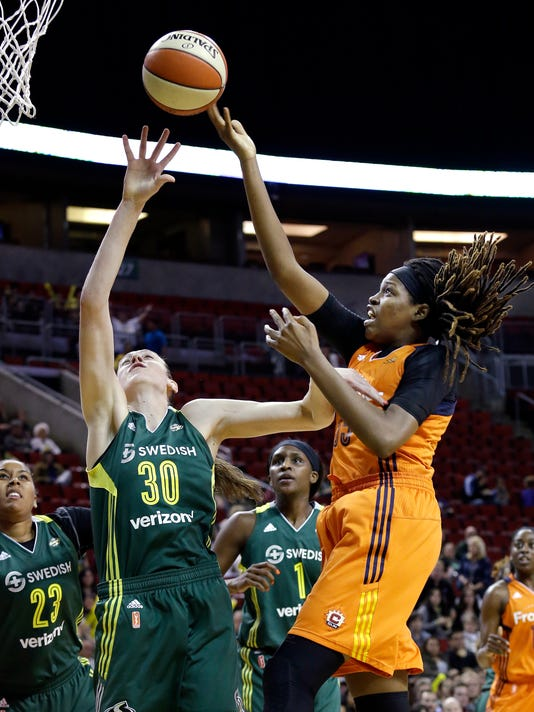Connecticut Sun's Jonquel Jones, right, reaches for a loose ball in front of Seattle Storm's Breanna Stewart (30) and Kaleena Mosqueda-Lewis (23) during the first half of a WNBA basketball game Saturday, May 28, 2016, in Seattle. (AP Photo/Elaine Thompson)