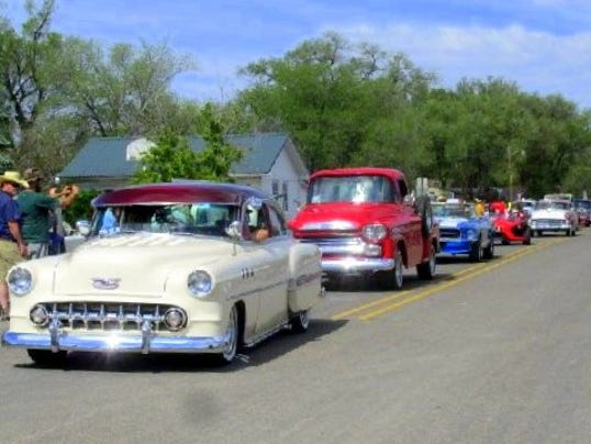 old cars at smokey bear days parade