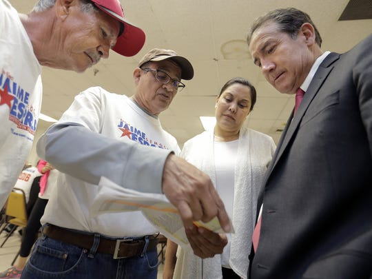 Jaime Esparza, second from left, goes over his campaign strategy with Enrique Moreno, right, Carla Monsisvais and Ben Saenz, left, during his election night watch party Tuesday at Bowl El Paso.