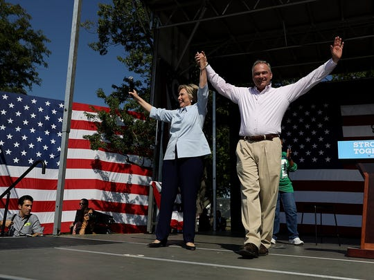 Hillary Clinton and Tim Kaine greet supporters during