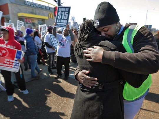 Ashley Cathey embraces Jayanni Webster as  hundreds of protesters gather outside the McDonald's at 2073 Union to demand a $15 minimum wage. Hoping to build on the anniversary of the 1968 Memphis sanitation workers strike, members of the organization Fight for $15 brought in union workers and labor activists from all over the Mid-South area for demonstrations to draw attention to minimum wage issues.