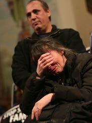 Flora Rranxburgaj of Southgate, Mich., cries Jan. 16,