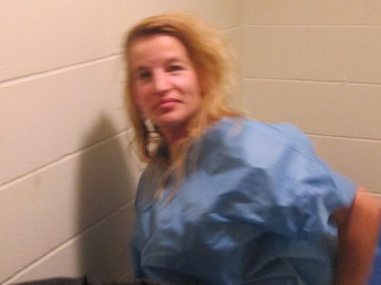 Jody Herring is seen in a cell at the Barre City Police Department after her arrest Friday. Defense lawyer Kelly Green was in the lobby seeking permission to talk to Herring.