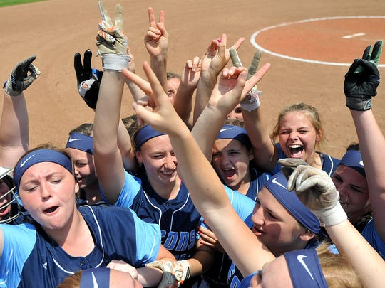 The Hillsdale softball players hold up two fingers, signifying they need two more wins after defeating Plymouth 3-2 Saturday afternoon at Kent State University.