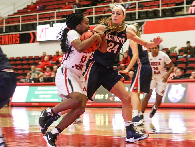 Austin Peay junior Bri Williams (13) tries to get past