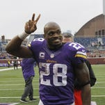 Minnesota Vikings running back Adrian Peterson (28) acknowledges the fans after Sunday's game against the Chicago Bears in Minneapolis. The Vikings defeated the Bears 38-17.