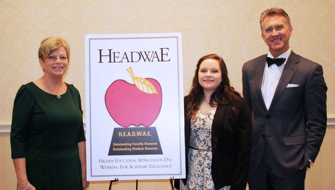 JCJC's HEADWAE recipients -- Fine Arts instructor Meri Newell, left, and student Faith Anderson -- are joined by JCJC President Jesse Smith at the annual HEADWAE luncheon in Jackson.