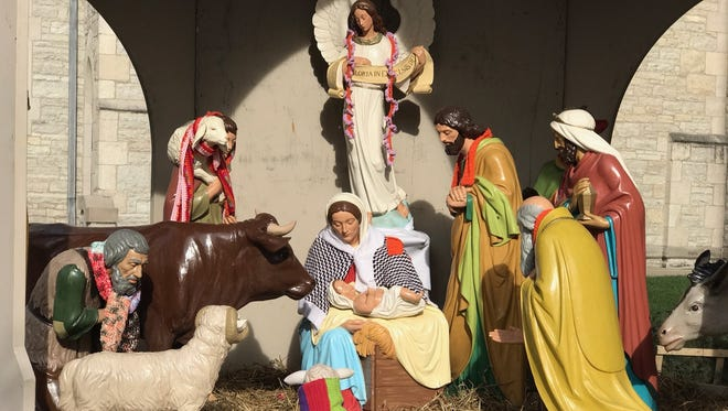 The Nativity scene is up at Christ Church Cathedral in Downtown Indianapolis. After several thefts of baby Jesus years ago, the church commissioned a new combined Mary-Jesus statue that is not so easily snatched.