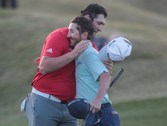 Jon Rahm, left, hugs competitor Andrew Landry after