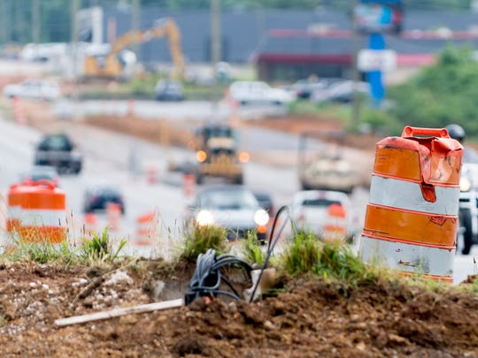 A construction cone sits in the dirt as work continues along Alcoa Highway between Woodson and Maloney Road in Knoxville, Tennessee on Wednesday, May 30, 2018. TDOT has been working to widen the road to three lanes since 2016.
