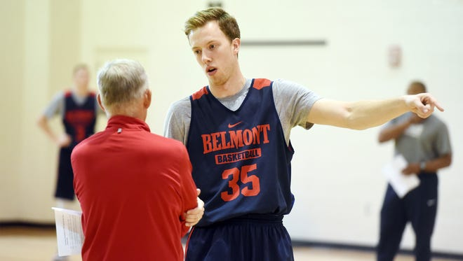 Evan Bradds, right, with Belmont coach Rick Byrd. Bradds was hired recently to write for MadMajorMadness.com.