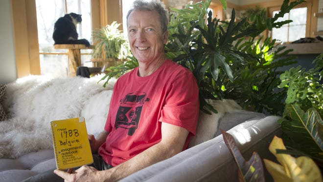 Jeff Lebesch, founder of New Belgium Brewing, poses for a photo with his original notes from a 1988 trip to Belgium at his home in Fort Collins on Tuesday, February 6, 2018. The trip to Belgium helped the Fat Tire Ale creators fondness for Belgian-style beers.