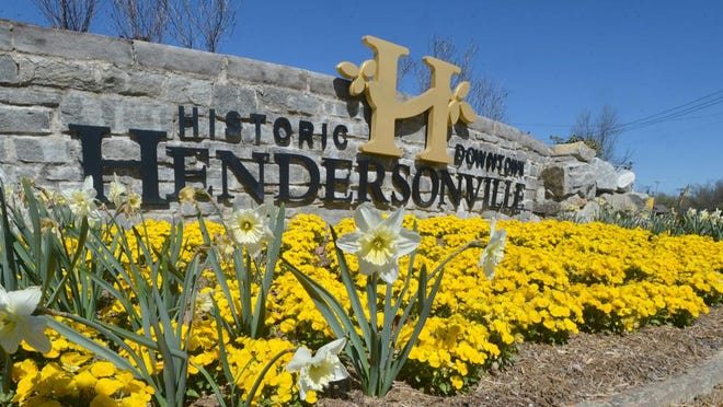 Flowers bloom below the Historic Downtown Hendersonville sign at Gateway Park on the South end of Main Street in this March 2016 photo.