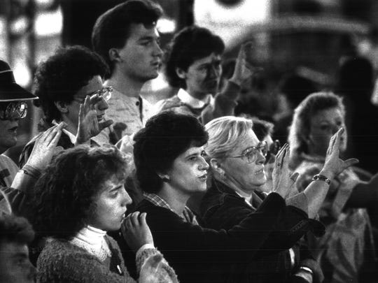 1988 - ROCHESTER: A deaf choir is signing at the Greater Rochester Billy Graham Crusade at Silver Stadium.