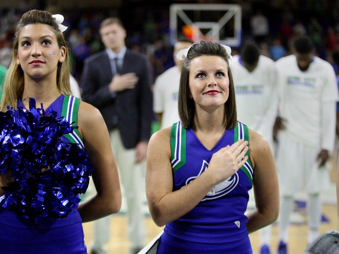 FGCU cheerleaders Zahra Fayad, left, and Darcy Williams