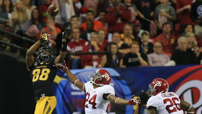 Missouri Tigers wide receiver Jimmie Hunt (88) makes a catch while defended by Alabama Crimson Tide defensive back Geno Smith (24) during the second quarter of the 2014 SEC Championship Game at the Georgia Dome.