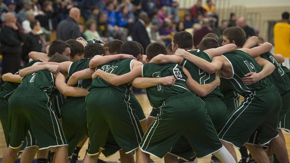 The James Buchanan Rockets, in their green jerseys, huddle up before a game at Greencastle-Antrim.