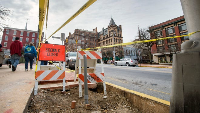 The sidewalk has been cut and electrical conduits are visible on the northeast corner of Continental Square in York city, where a charging station will be installed for electric vehicles.