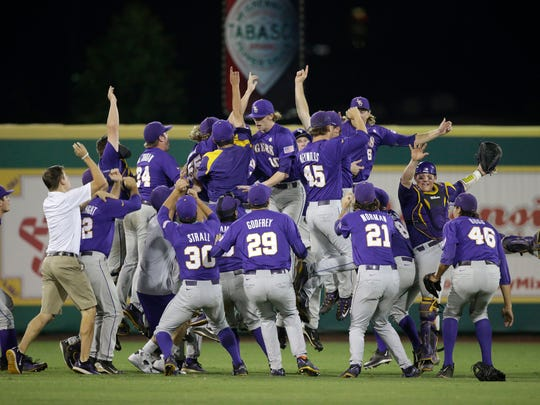 LSU celebrates after defeating Louisiana-Lafayette in game two of their Super Regional series on Sunday in Baton Rouge, La.