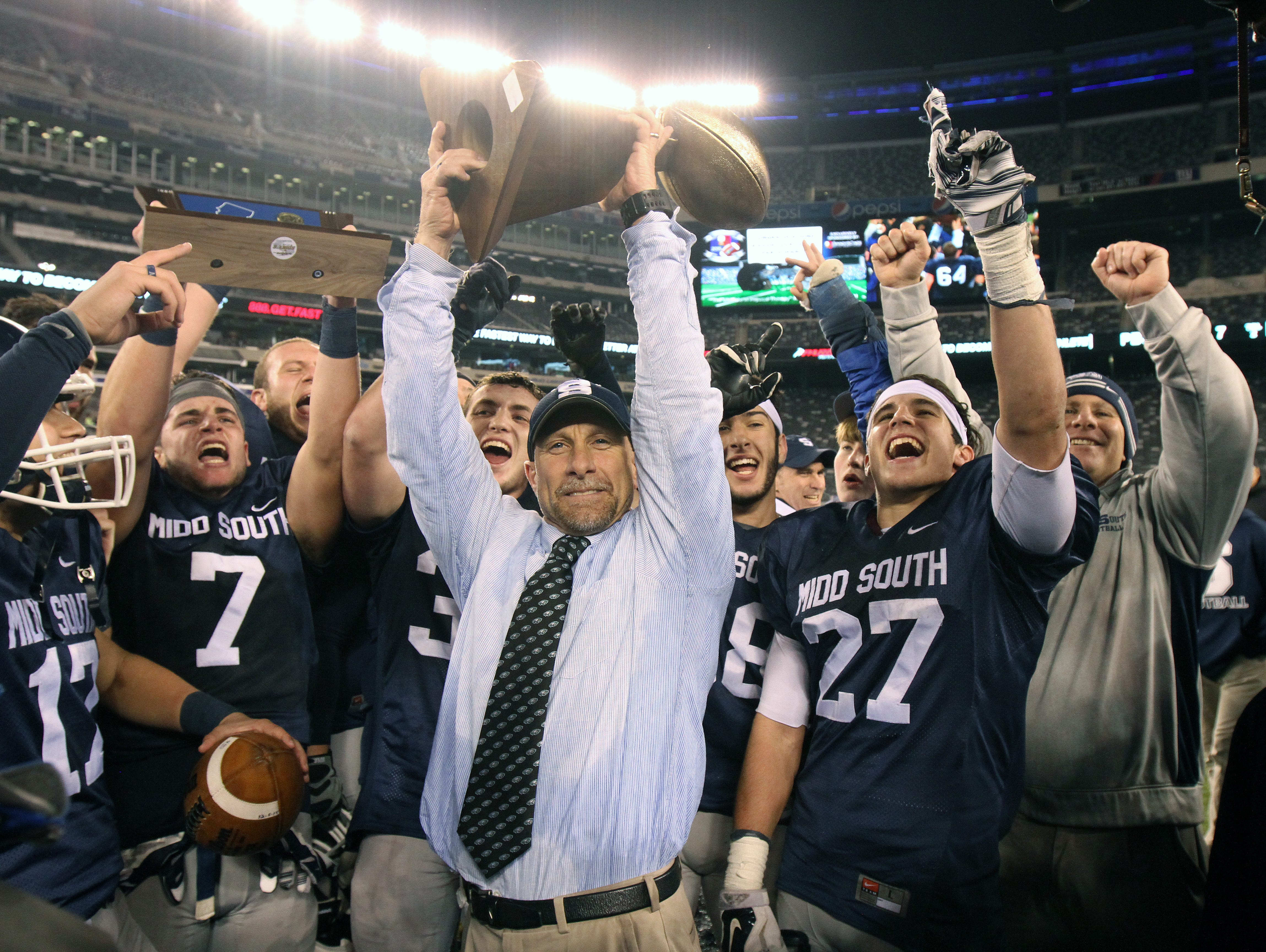 Head coach Steve Antonucci (center) and the Middletown South players celebrate after the Eagles' 35-7 win over Phillipsburg in the NJSIAA North II, Group IV championship game at MetLife Stadium. Middletown South finishes No. 1 in the Asbury Park Press Top 10.