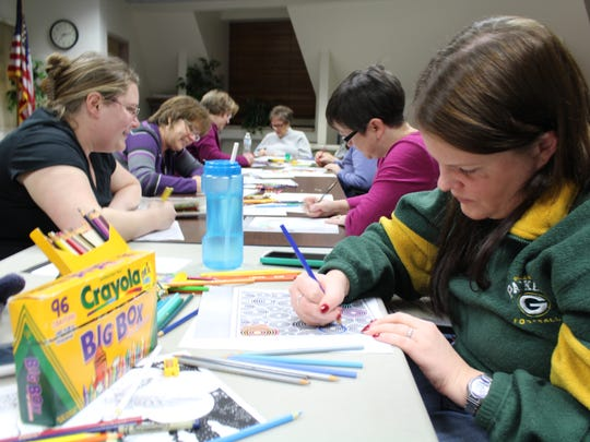 "Attendees at the Marathon County Public Library-Wausau color at ""Inside the Lines: Adult Coloring Party"" on Dec. 28, 2015."