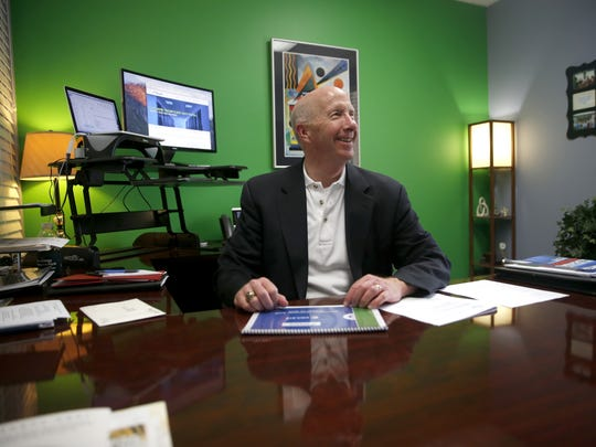 Coaxis International COO Jim Hunt sits in his office at the company's headquarters in Tallahassee on Wednesday, April 6, 2016.