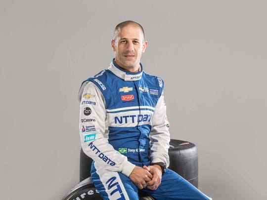 Tony Kanaan poses for photos during Indy Car Media Day at the Indianapolis Motor Speedway, February 2, 2015.