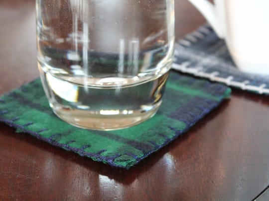 Plaid flannel coasters add a cozy touch to the coffee table.