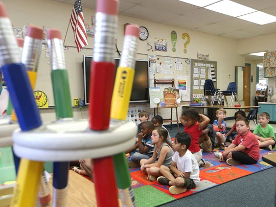 Kindergarten classes, like this one at Kate Sullivan Elementary are poised to see a new grading scale next year.