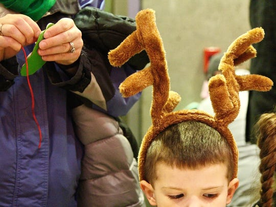 Declan Reeves, 4, of Salem creates Christmas ornaments at the Salem Convention Center Annual Holiday Tree Lighting ceremony on Sunday, Nov. 26, 2017.