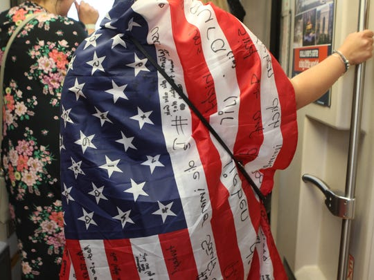 Laura Heitsch sported a flag that her friends wrote