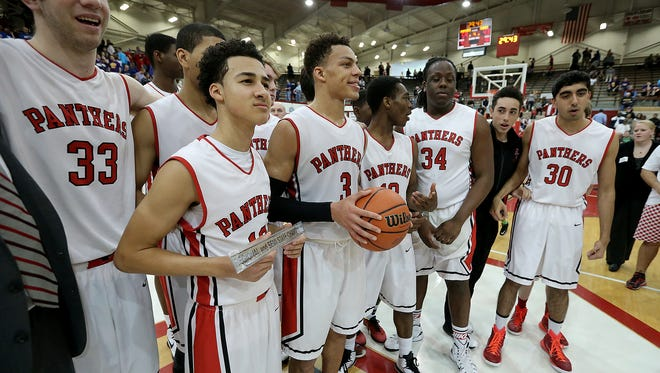 Park Tudor Panthers celebrate their win in the IHSAA boys 2A Semistate Saturday, March21, 2015,  at Southport High School. Park Tudor defeated  Linton-Stockton 59-43.