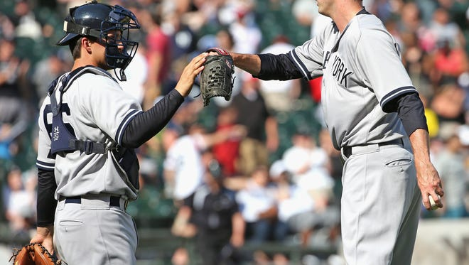 Pitcher Andrew Miller of the Yankees is congratulated by catcher John Ryan Murphy after a win over the Chicago White Sox on Sunday