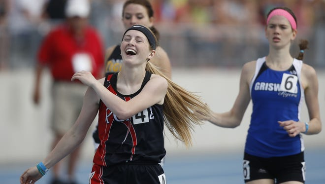 Pekin of Packwood's Gwynne Wright is overjoyed after winning her first state track title in the Class 1-A 800.