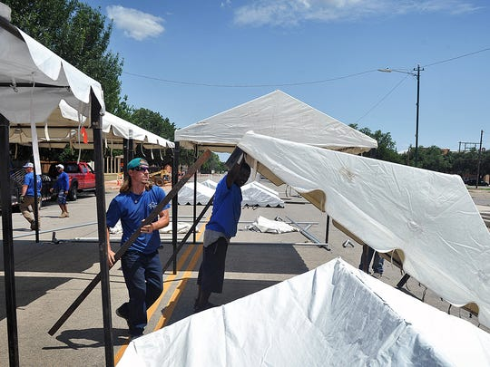 A crew with Century Tent erects tents for the Art and Soul art festival downtown on Ohio Street Friday afternoon. Approximately 50 artists, live music, and food will be included in the festivities Saturday afternoon and evening.