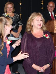 Cheryl Carreon, right, reacts in disbelief to hearing her name called by Superintendent Stan Rounds, as she is named the 2017 Las Cruces Public Schools' Teacher of the Year.  Looking on are 1st Runner-Up Melody Hagaman, Centennial High School teacher, and 2nd Runner-Up Tamara Miller-Dwake, (behind) teacher from Arrowhead Park Early College High School.