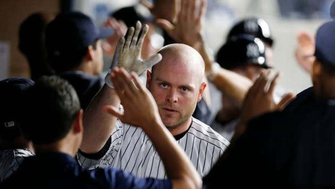 Teammates greet New York Yankees Brian McCann, center, in the dugout after McCann's game-tying, three-run homer off Texas Rangers relief pitcher Sam Dyson in a baseball game in New York, Wednesday, June 29, 2016. The Yankees came from behind to defeat the Rangers 9-7.