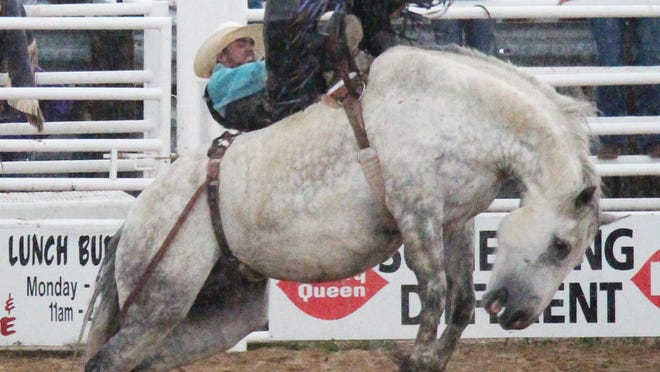 Josh Parker of Las Animas on his bareback ride on Friday. Parker won the event with a 90-point ride.