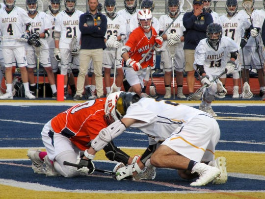 Hartland's Jake DeYoung (right) was an all-state faceoff